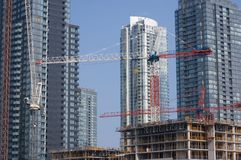 Development, New Constraction. New construction against brand new buildings. Concept for development stock image