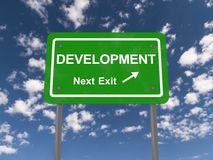 Development next exit sign Stock Photos