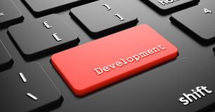 Development on Red Keyboard Button. Stock Image