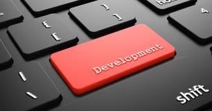 Development on Red Keyboard Button. Development on Red Button Enter on Black Computer Keyboard Stock Image