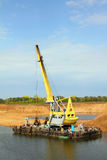 Development sandpit with dredge. Floating excavator - development sandpit with dredge Royalty Free Stock Photography