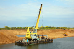 Development sandpit with dredge. Floating excavator - development sandpit with dredge Stock Photos