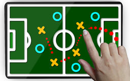 Development of a strategy.Hand moving a team to reach the goal Royalty Free Stock Photo