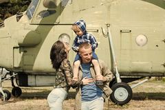 Development and upbringing concept. Mother and father and their child walking in aviation museum outdoors. Happy family Royalty Free Stock Photography