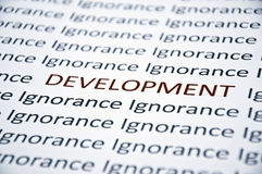 Development word. Highlighted red against ignorance word Stock Photo