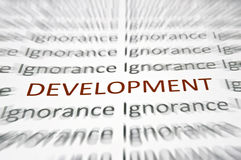 Development word. Highlighted red against ignorance word Stock Images
