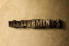 DEVELOPMENTS - close-up of grungy vintage typeset word on metal backdrop Stock Photo