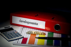 Developments on red business binder Stock Photos