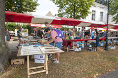The Deventer book market in the Netherlands on august 3, 2014. The boulevard crowded with people scouring the book stalls. DEVENTER, THE NETHERLANDS - AUGUST 3 Stock Images