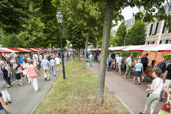 The Deventer book market in the Netherlands on august 3, 2014. The crowded promenade with people scouring the book stalls. DEVENTER, THE NETHERLANDS - AUGUST 3 Royalty Free Stock Photography