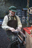 Man is busy with the figure saw at the Dickens Festval in Devent. Deventer, Netherlands – December 18, 2016: Man is busy with the figure saw at the Dickens Royalty Free Stock Photography