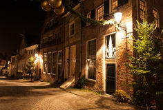 Deventer at night in a Dickens street. Before Christmas Stock Photography