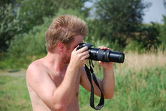 Deviant photographer. Watching his target Royalty Free Stock Photography