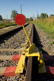 The device blocking the movement of trains on the railway tracks.  royalty free stock image