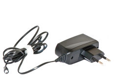 The device for cellular phone. Mobile phone battery charger Stock Images
