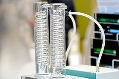 Glass tubes with glass spirals inside. Device for chemical laboratory: glass tubes with glass spirals inside. Small depth of sharpness Stock Image