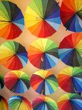 Colorful umbrellas hanging on the ceiling royalty free stock photos