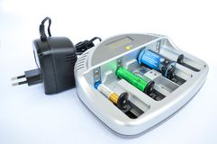 Device designed to charge batteries with inserted batteries. Of three types - A, AA, AAA stock photo
