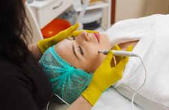 The device is facial cosmetology. royalty free stock photography