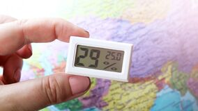 Free Device For Measuring Humidity And Temperature, Map Background Royalty Free Stock Photo - 215481085