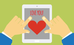 Device with heart on the screen holding in hands Stock Images