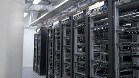 Device for mining crypto currency. Row of bitcoin miners set up on the wired shelfs. Mining cryptocurrency. Bitcoin farm Stock Image