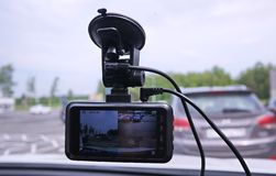 A device for monitoring the situation on the road. Installed in the car. Details and close-up royalty free stock images