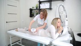Device for removing excess fat. The device for carrying out LPG massage. Application of the device to the client of the beauty salon stock video footage