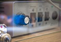 Device to control the voltage of the electrical relay. Blurred background. royalty free stock images