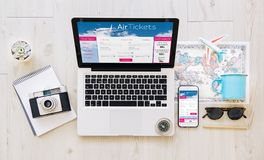 Devices with air tickets responsive web. Mobile and laptop with air tickets responsive website. All graphics are made up Royalty Free Stock Photography