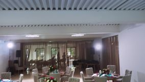 Devices for disco light fixed on the farm ceiling and the overall plan of the restaurant`s interior. Steadycam shot stock video