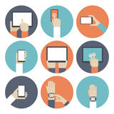 Devices in hand, using touch screen Stock Image