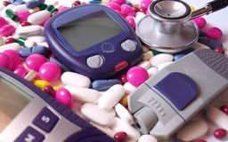 Devices for measuring blood sugar level and pills Royalty Free Stock Images