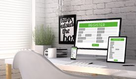Devices with a registration form on the screen on a workplace mo. Devices mock up with a registration form on the screen on an hardwood desk. Screen graphics are Royalty Free Stock Photo