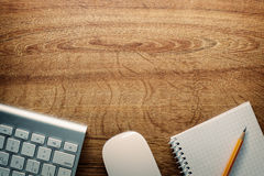 Devices, Pencil and Notes on Desk with Copy Space. Close up Computer Keyboard and Mouse , Pencil and Graphing Notebook on Top of Wooden Desk with Copy Space stock image