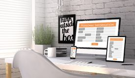 Devices with a personal information form on the screen on a work. Devices mock up with a responsive personal information form on the screen on an hardwood desk Stock Image