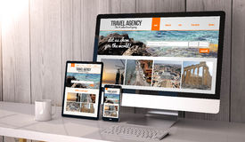 Devices responsive on workspace travel agency online. Digital generated devices on desktop, responsive blank mock-up with travel agency website  on screen. All Royalty Free Stock Images