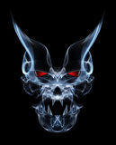 Devil. Abstract smoke devil with red eyes on black background Royalty Free Stock Photo
