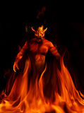 Devil. A devil standing in depths on fire Stock Photo