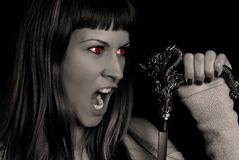 Devil. Girl looking at dragon sword stock photos