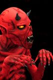 Devil. Halloween devil-like red monster to scare royalty free stock photography