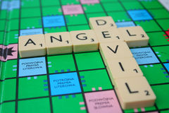 Devil and angel. Inscription made of scrabble tiles Royalty Free Stock Photography
