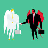 Devil and angel business deal. Satan and God handshake. Archange Stock Photo