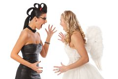 Devil and angel fighting Stock Image