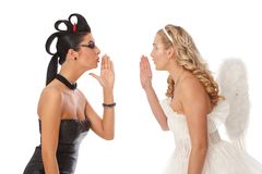 Devil and angel whispering Royalty Free Stock Image