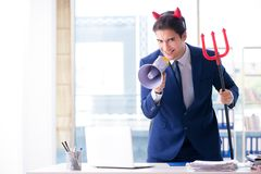 The devil angry businessman in the office Stock Photo