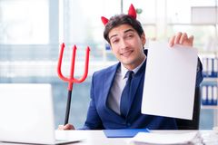 The devil angry businessman in the office Royalty Free Stock Photography