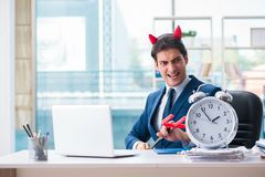 The devil angry businessman in the office. Devil angry businessman in the office royalty free stock images