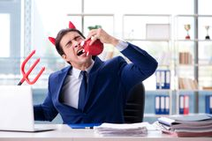 The devil angry businessman in the office. Devil angry businessman in the office Stock Photos