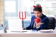 The devil angry businessman in the office. Devil angry businessman in the office Stock Photo